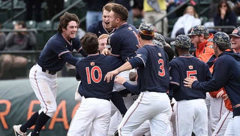 Auburn celebrates Conor Davis' walk-off single against Ole Miss on Saturday, April 20, 2019 in Auburn, Ala. Credit: Meredith Kramer / Auburn Athletics.