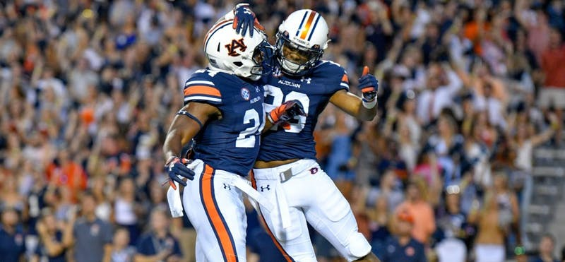Daniel Thomas (24) and Ryan Davis (23) celebrate after a touchdown during  Auburn Football vs. Arkansas on Saturday, Sept. 22, 2018 in Auburn, Ala.