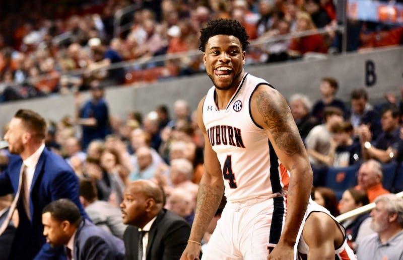 Malik Dunbar (4) celebrates during Auburn Men's Basketball vs. Florida on Tuesday, Feb. 5, 2019, in Auburn, Ala.