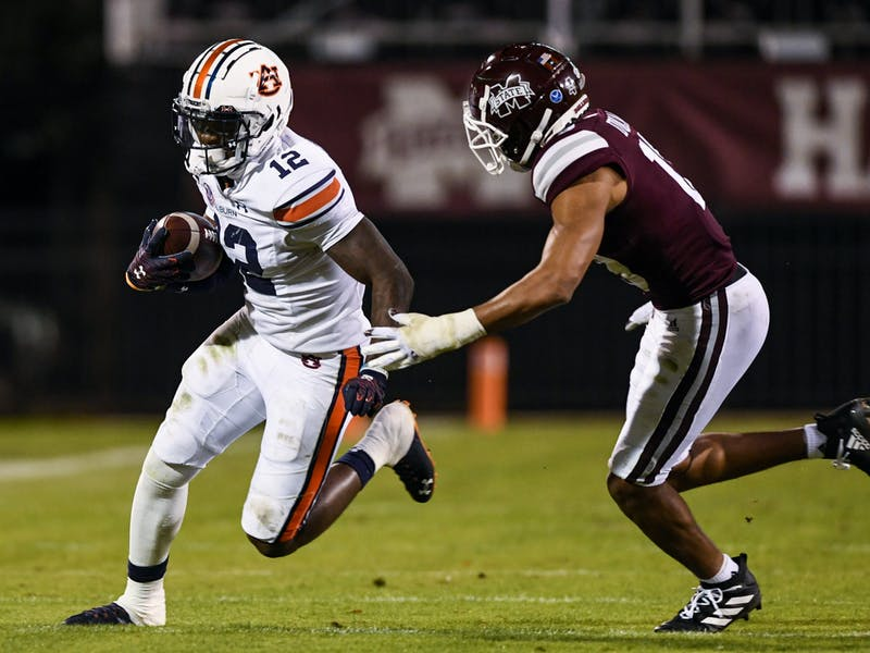 Oct 3, 2020; Starkville, Mississippi, USA; Eli Stove (12) runs the ball during the game between Auburn and Mississippi State at Davis Wade Stadium. Mandatory Credit: Todd Van Emst/AU Athletics