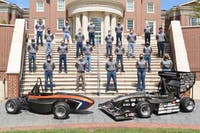 The War Eagle Motorsports team poses behind their electric and combustion cars.