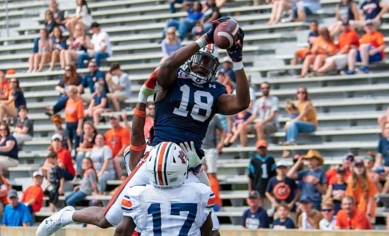 Seth Williams (18) catches a touchdown over Roger McCreary (17) during Auburn's A-Day spring game on April 13, 2019, in Auburn, Ala.