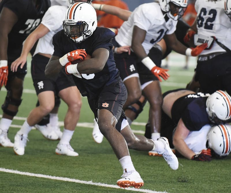 JaTarvious Whitlow runs in team drills Sunday.