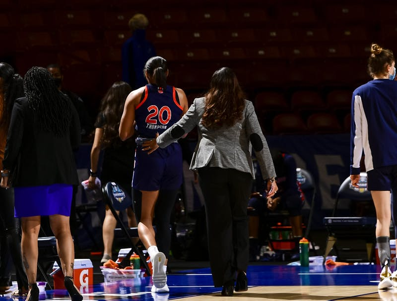 UNIQUE THOMPSON and coach TERRI WILLIAMS-FLOURNOY walk off the court after their game against Florida Wednesday.Auburn vs FloridaSEC Women's Basketball Tournament on Wednesday, March 3, 2020 in Greenville, SC.Todd Van Emst/SEC
