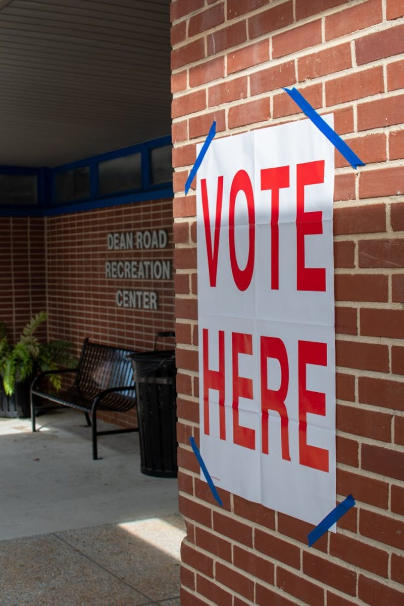 A vote here sign sits outside the Dean Road recreation center on Tuesday, Oct. 9, 2018, in Auburn, Ala.