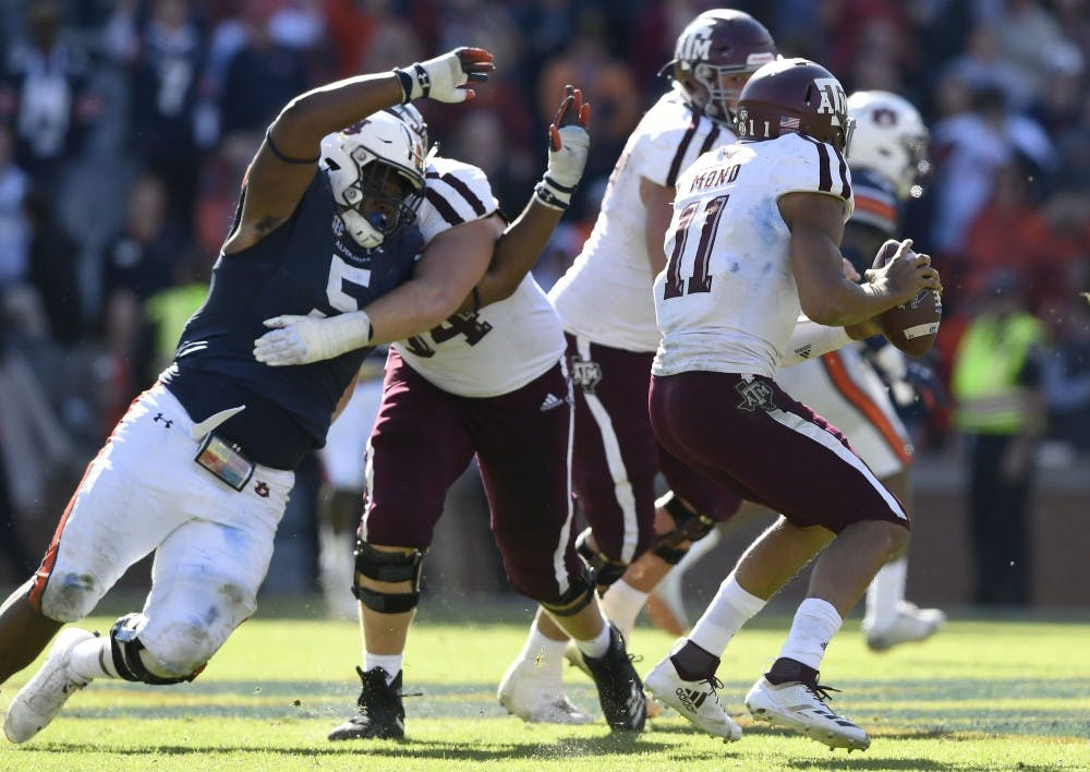 Defensive line ramping up play at the right time for Auburn