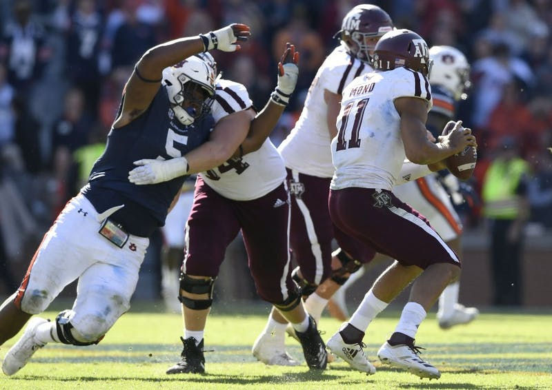 Auburn's Derrick Brown pressures A&M quarterback Mond Kellen in the second half. Texas A&M was called for a hold on the play. Texas A&M at Auburn football on Saturday, Nov 3, 2018 in Auburn, Ala.