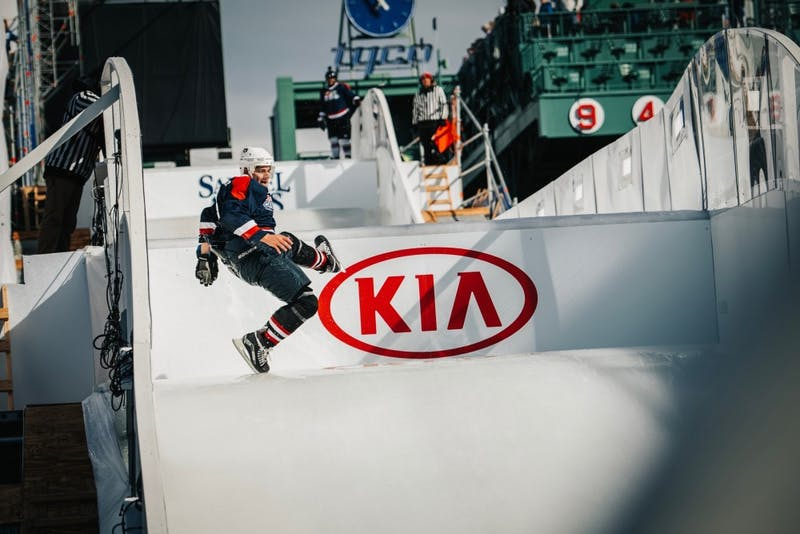 "Seth Baylis participates in ""ice cross downhill"" at Fenway Park in Boston, Mass."