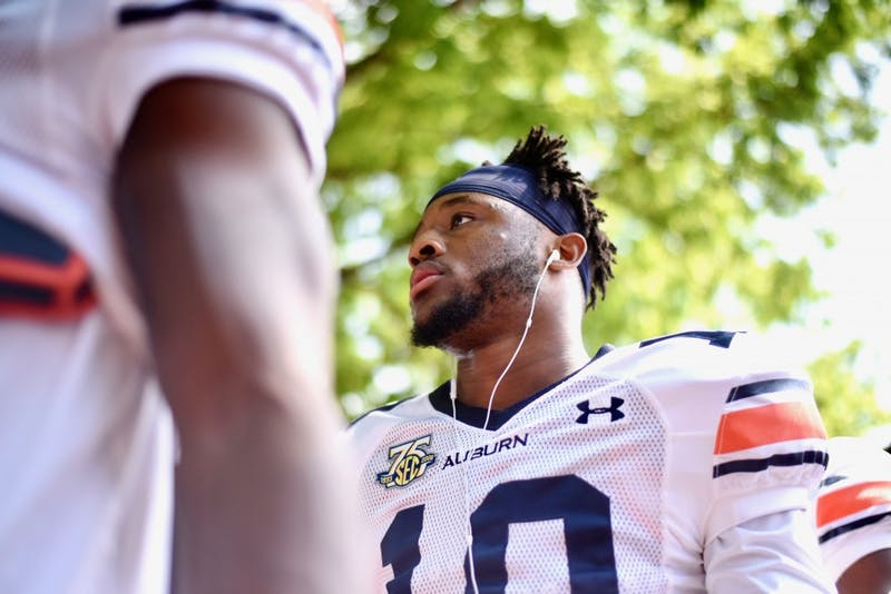 Owen Pappoe (10) during Tiger Walk before A-Day on Saturday, April 13, 2019, in Auburn, Ala.