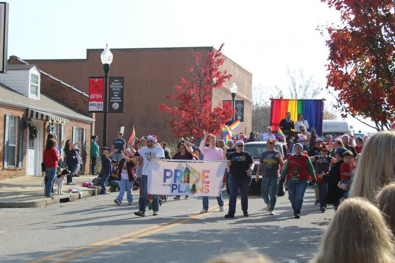 Pride on the Plains, a local LGBTQ organization, marches through the annual Opelika Christmas parade on Dec. 2, 2017, in Opelika, Ala.