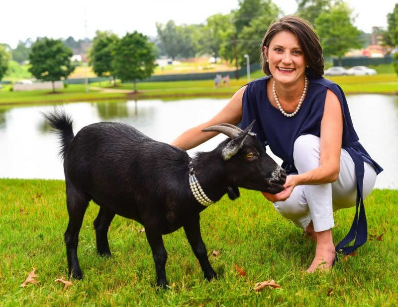 Mary Wynne Kling, democratic candidate running for House District 79, poses with a goat. (Contributed by Mary Wynne Kling)