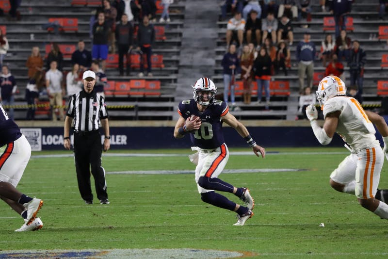 Bo Nix (10) runs the ball during Auburn vs. Tennessee on Nov. 21, 2020, in Auburn, Ala.