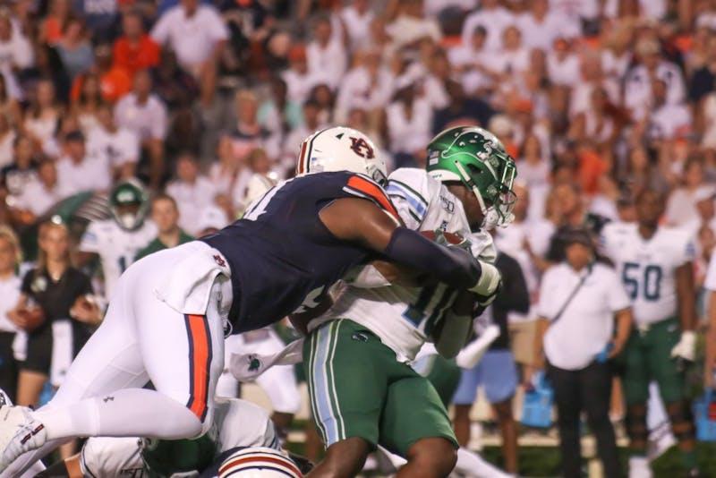 Darius Bradwell gets tackled on Saturday, Sep. 7, 2019 in Auburn, Ala.