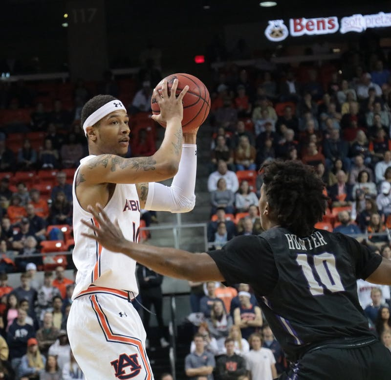 Samir Doughty (10) looks to pass the ball during Auburn basketball vs. Furman.