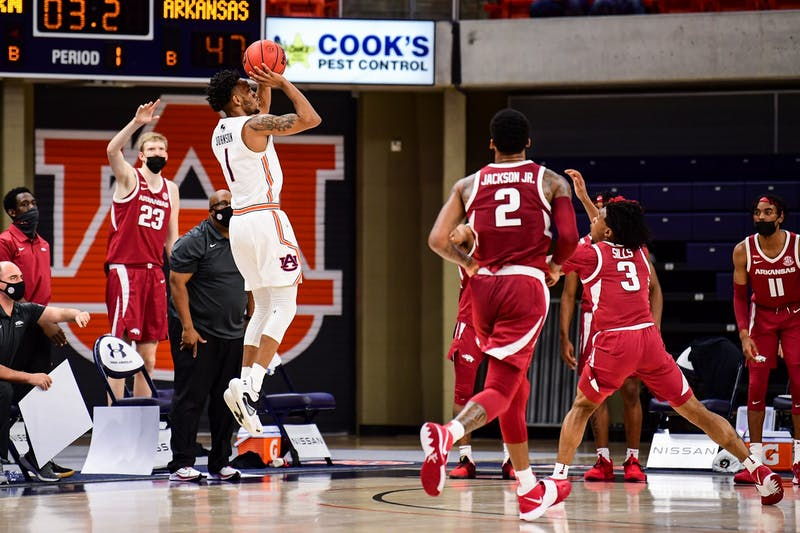 Dec 30, 2020; Auburn, AL, USA; Auburn Tigers guard Jamal Johnson (1) shoots a three during during the game between Auburn and Arkansas at Auburn Arena. Mandatory Credit: Shanna Lockwood/AU Athletics