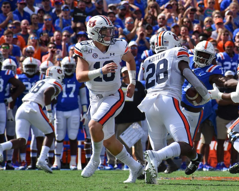 Bo Nix hands the ball off to Whitlow during Auburn vs. Florida, on Saturday, Oct. 5, 2019, in Gainesville, Fl.