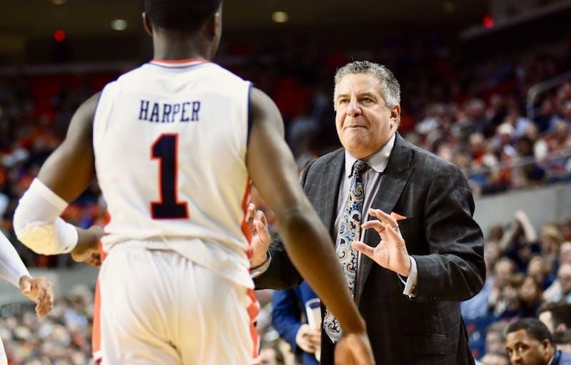 Bruce Pearl talks to Jared Harper (1) during Auburn Men's Basketball vs. Florida on Tuesday, Feb. 5, 2019, in Auburn, Ala.