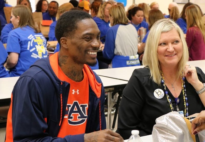 Auburn assistant coach Marquis Daniels visits Beauregard Elementary School on Monday, March 11, 2019, in Beauregard, Alabama. Photo via Cody Voga, Auburn Athletics.