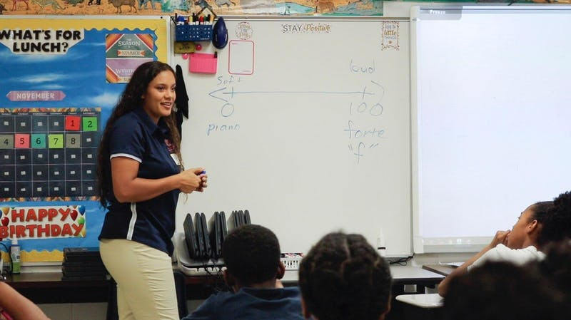 Brianna Jarvis, sophomore in music education, teaches a lesson on dynamics to a class.