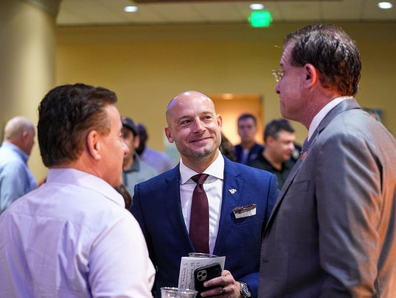 P.J. Fleck (middle) and Gus Malzahn (right) before the Outback Bowl joint press conference in Tampa, Fla. Photo via @GopherFootball on Twitter.