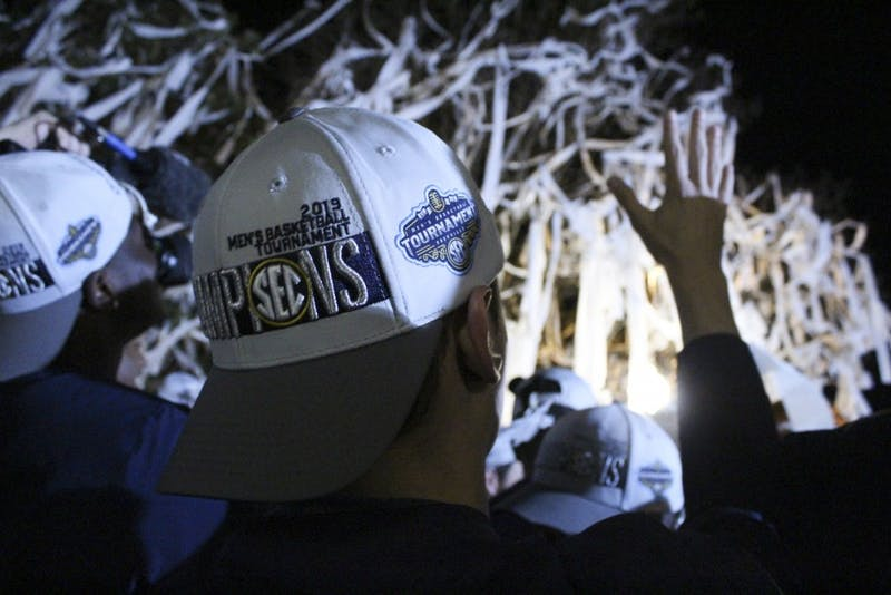 The Auburn Men's Basketball Team rolls Toomer's Corner to celebrate their SEC Tournament Championship win on Sunday, March 17, 2019, in Auburn, Ala.