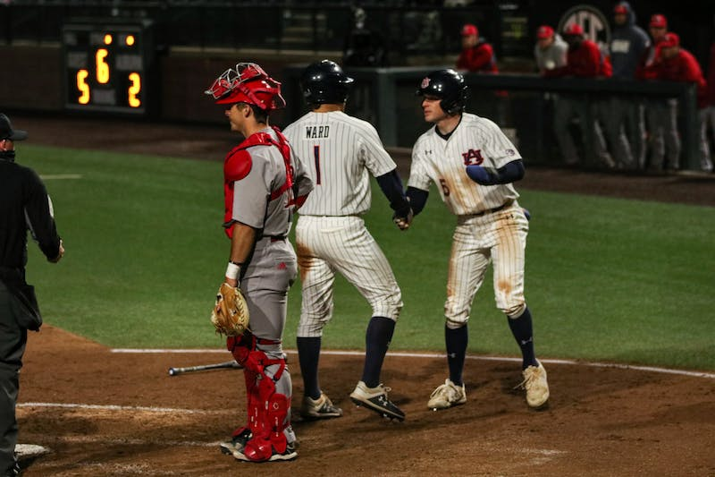 Feb 19, 2021; Auburn, AL, USA; Auburn Tigers outfielder Judd Ward (1) and Kason Howell (5) react after getting to home during the game between Auburn and Jacksonville State at Plainsman Park. Mandatory Credit: Jacob Taylor/AU Athletics