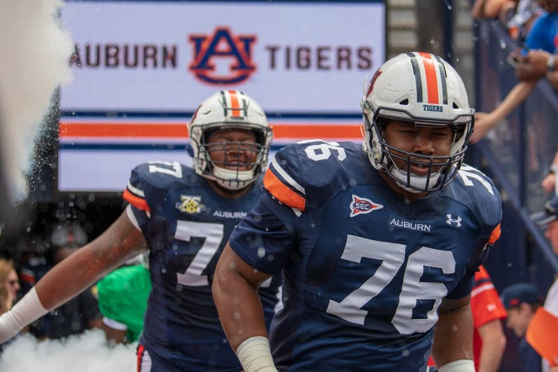 Prince Tega Wanogho (76) runs out of the tunnel during A-Day 2019, on Saturday, April 13, 2019, in Auburn, Ala.