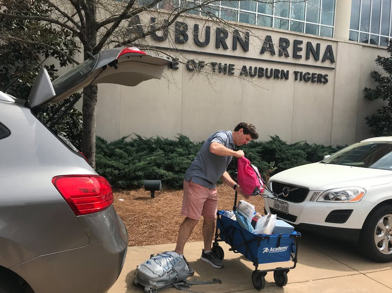 Lowdell Sand helps his daughter, Hallie Sand, pack as they prepare to drive back home to Dallas, Texas, on Sunday, March 15.