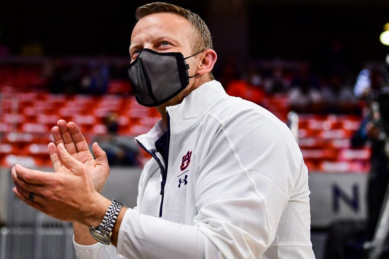 Dec 30, 2020; Auburn, AL, USA; Auburn Tigers football head coach Bryan Harsin reacts during during the game between Auburn and Arkansas at Auburn Arena. Mandatory Credit: Shanna Lockwood/AU Athletics