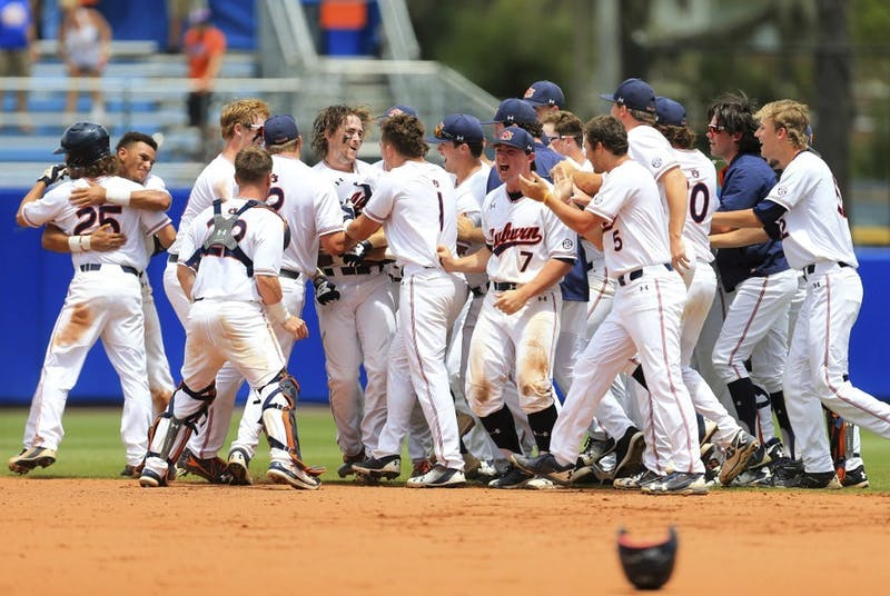 Auburn celebrates after a walk-off single by Luke Jarvis against Florida during the ninth inning of an NCAA Super Regional college baseball game Sunday, June 10, 2018, in Gainesville, Fla. (AP Photo/Matt Stamey)