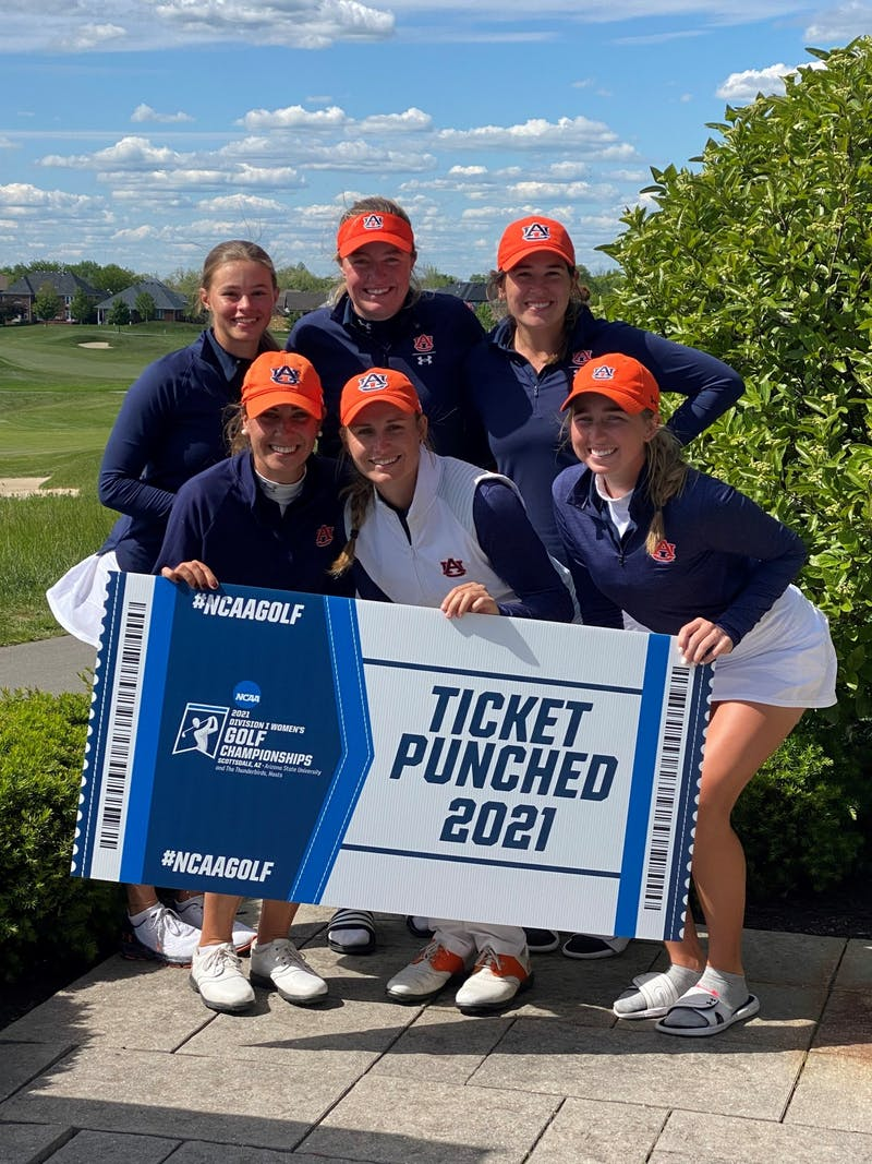 Members of the Auburn women's golf team celebrate after securing a spot in the NCAA Championship on May 12, 2021.