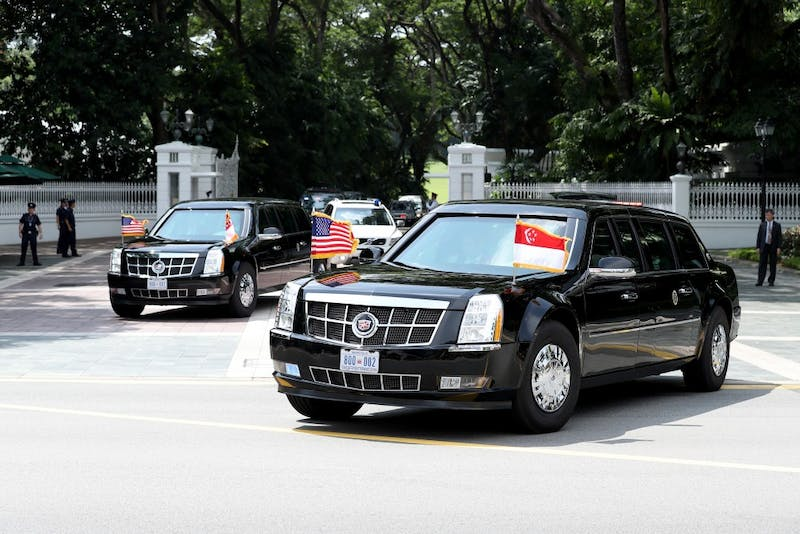 A motorcade transporting U.S. President Donald Trump departs The Istana following a meeting with Singapore Prime Minister Lee Hsien Loong on Monday, June 11, 2018. Trump and North Korea's Kim Jong-un, are expected to discuss the denuclearization of the Korean peninsula and lifting of economic sanctions currently imposed on the nation in tomorrow's summit. (Paul Miller/Zuma Press/TNS)