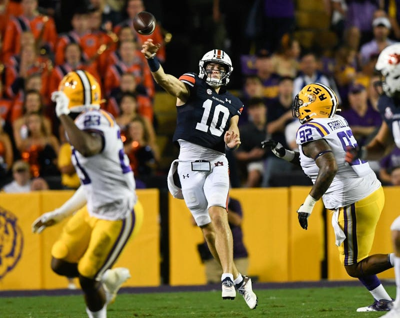 Oct 2, 2021; Baton Rouge, LA, USA; Bo Nix (10) throws between Auburn and Louisiana State University at Tiger Stadium. Mandatory Credit: Todd Van Emst/AU Athletics