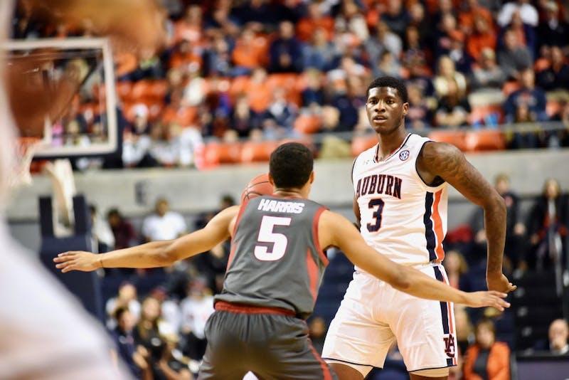 Danjel Purifoy (3) looks to make a pass during Auburn Men's Basketball vs. Arkansas on Feb. 20, 2019, in Auburn, Ala.