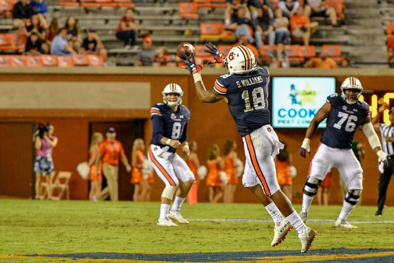 Seth Williams (18) reaches to catch a ball from Jarrett Stidham (8) during Auburn Football Vs. Southern Miss on Saturday, Sept. 29, in Auburn, Ala.