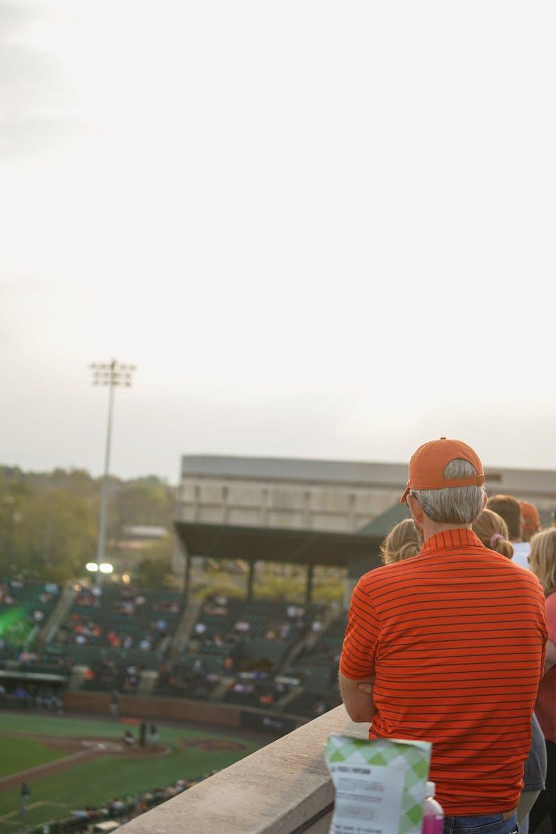 Fans watch an Auburn vs. Kentucky baseball game on top of the student parking deck on Mar. 26, 2021 in Auburn, Ala.