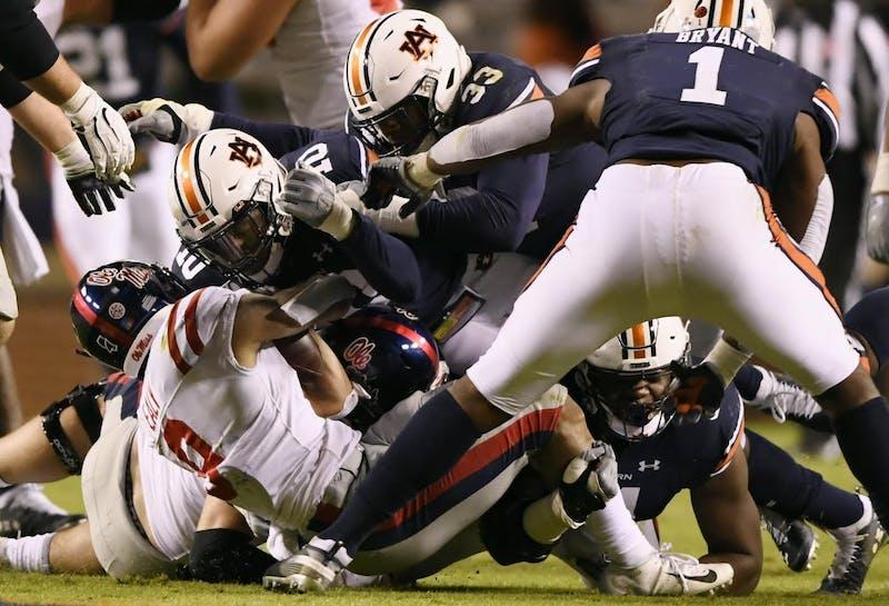 Auburn's defense makes a tackle during Auburn vs. Ole Miss on Nov. 2, 2019, in Auburn, Ala.