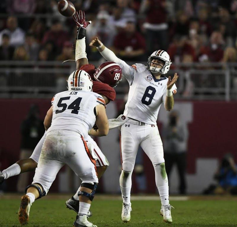 Auburn quarterback Jarrett Stidham throws a touchdown to Darius Slayton in the second half. Auburn at Alabama football, Iron Bowl, on Saturday, Nov 24, 2018 in Tuscaloosa, Ala.