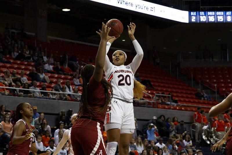 Auburn's Unique Thompson (20) jumps for the basket during the Auburn v. Alabama women's basketball game on January 12, 2020 in Auburn, AL.