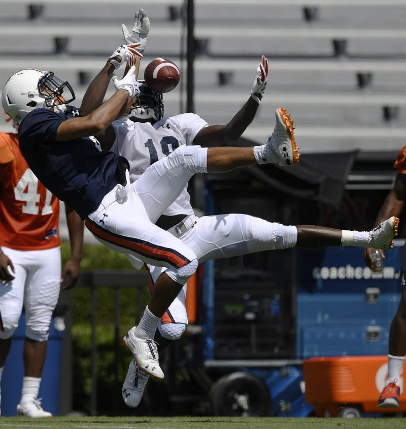Defender Jayvaughn Myers takes the ball and makes the interception from receiver Anthony Schwartz during scrimmage Thursday.Auburn football scrimmage on Thursday, Aug. 9, 2018 in Auburn, Ala.Todd Van Emst/AU Athletics