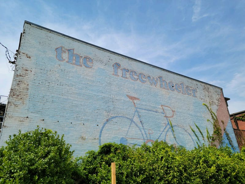The Freewheeler, a mural on the side of an old bicycle shop on College Street, is one of few pieces of public art in downtown Auburn.