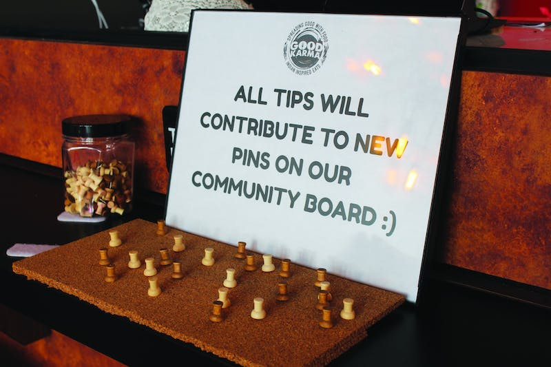 The owner of Good Karma puts a community board inside the restaurant to help those in need.