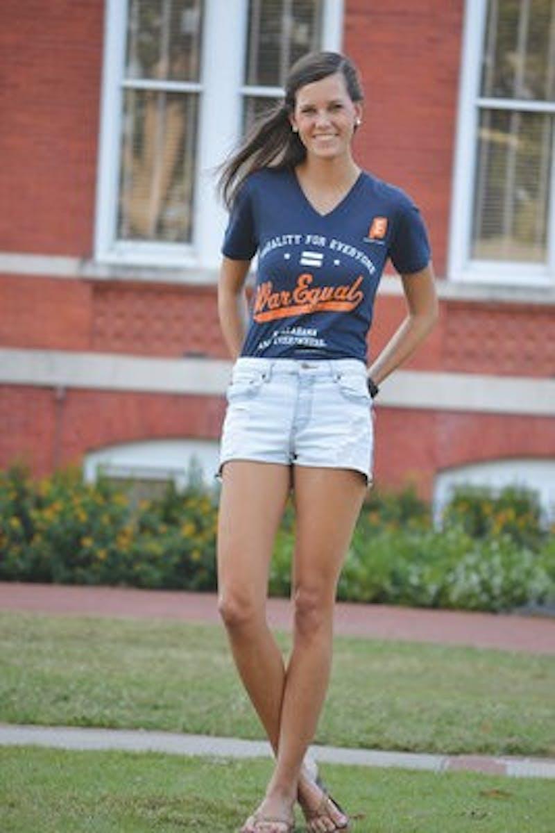 Margo Kaestner models the Auburn-themed War Equal shirt for Equality Alabama.