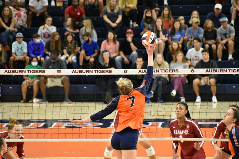 Oct. 3, 2021; Auburn, AL, USA; Rebekah Rath (7) gently lifts the ball over the net in a match between Auburn and Alabama in the Auburn Arena.