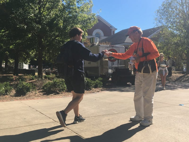 Ray Tarrer hands out pamphlets in front of Parker Hall on October 29, 2018 in Auburn, Ala.
