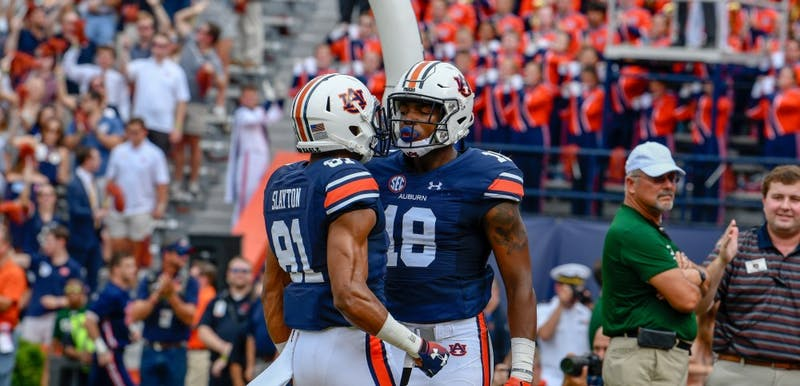 Seth Williams (18) and Darius Slayton (81) celebrate a touchdown during Auburn football vs. Southern Miss on Sept. 29, 2018, in Auburn, Ala.