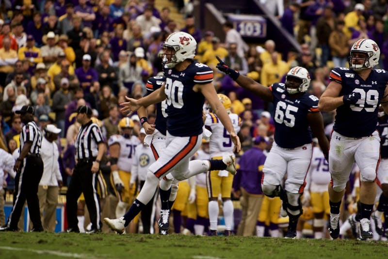 Arryn Siposs (90) celebrates one of his punts during the Auburn vs. LSU game Saturday Oct. 26, 2019, in Baton Rogue, La.