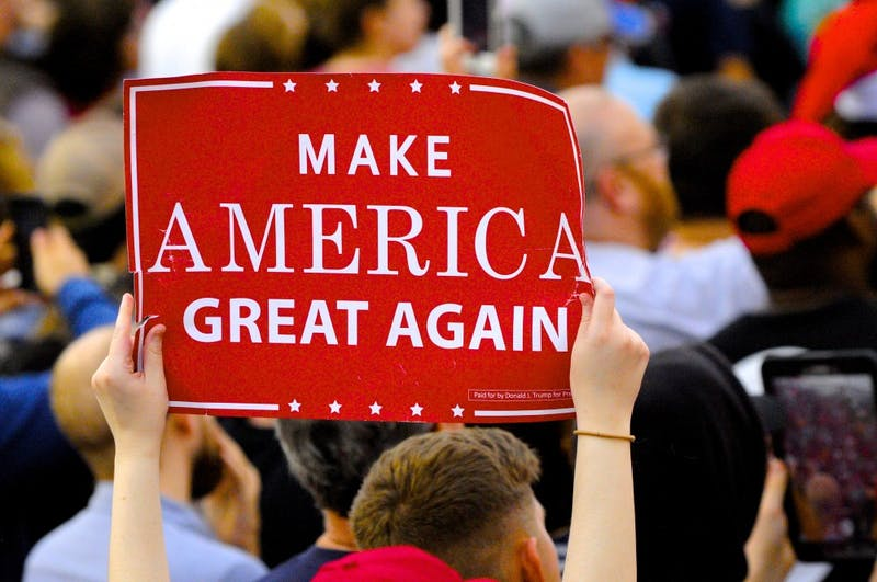 A Trump supporter holds a rally sign at a Trump event in Mobile, Alabama, in December 2016. Voters in Auburn head to the polls Monday in a primary marked by who will be most supportive of Trump's agenda.