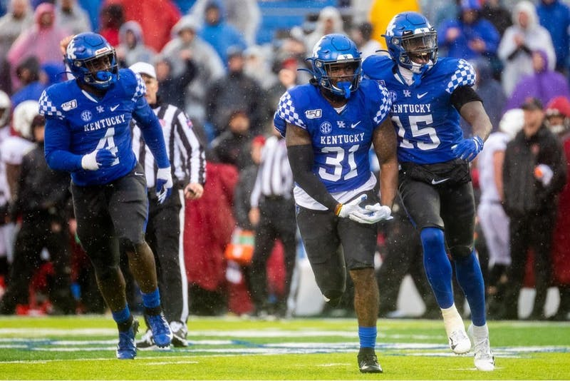 Kentucky Wildcats linebacker Jamar Watson (31) and Kentucky Wildcats linebacker Jordan Wright (15) celebrate during the University of Kentucky vs. University of Louisville Governor's Cup football game on Saturday, Nov. 30, 2019, at Kroger Field in Lexington, Kentucky. UK won 45-13. Photo by Michael Clubb | Staff | The Kentucky Kernel.