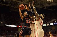 Isaac Okoro (23) shoots over South Alabama defenders during Auburn basketball at South Alabama on Nov. 12, 2019, in Mobile, Ala.